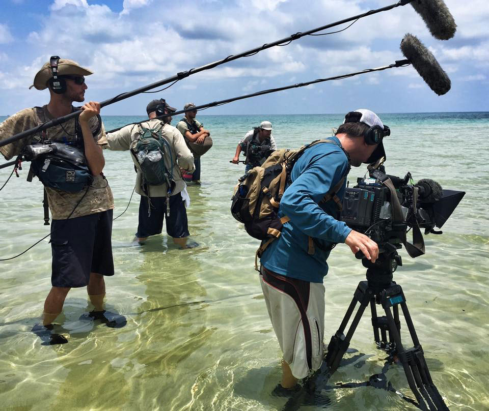 Justin Lacroix capturing sound for Survivor on the beach in Cambodia.